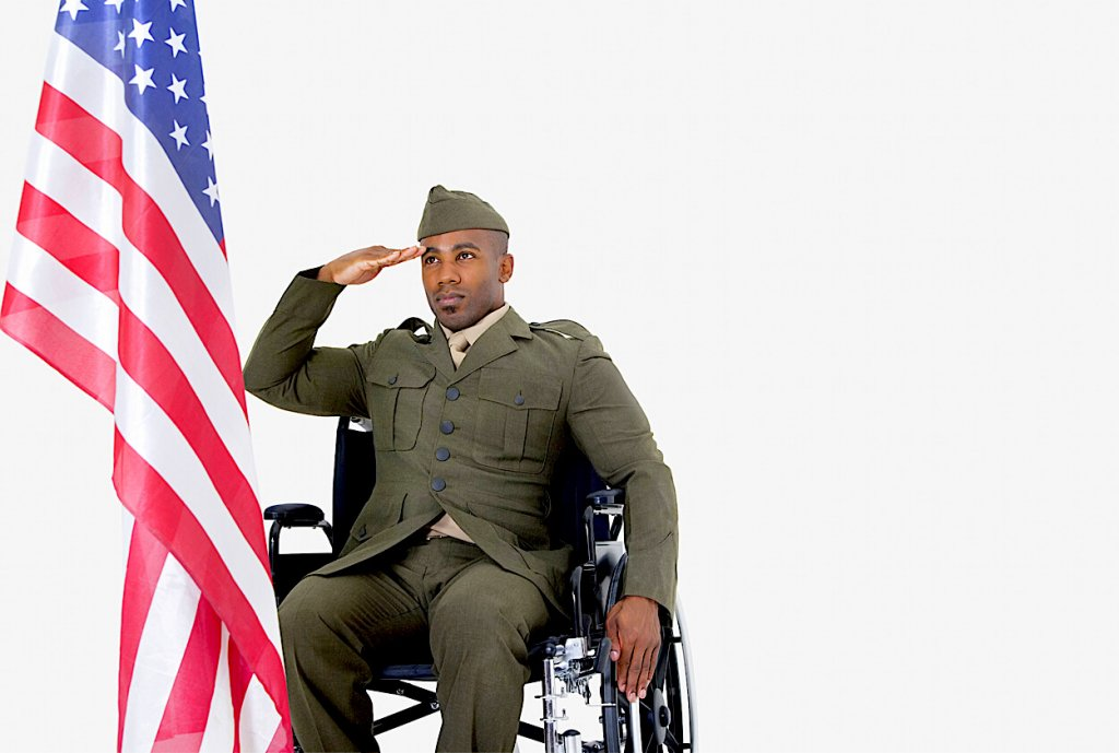 Young Soldier in Wheelchair Saluting the American Flag