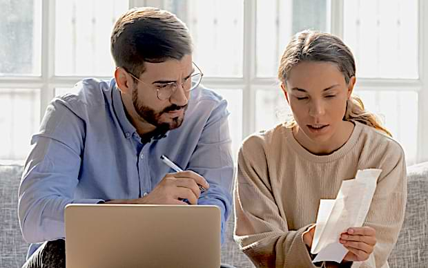 Young couple doing estate planning