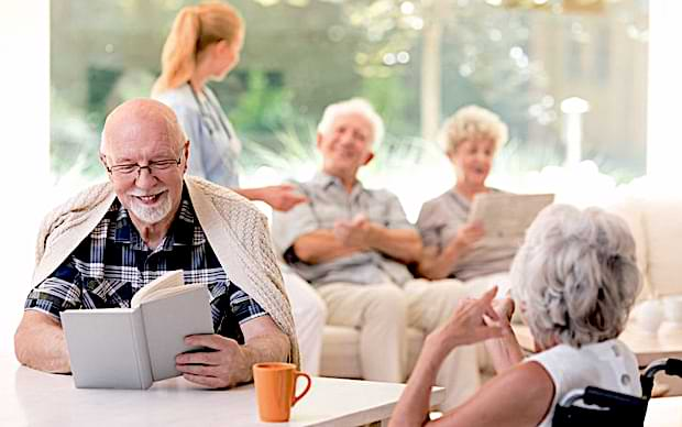 Happy seniors in an assisted living community